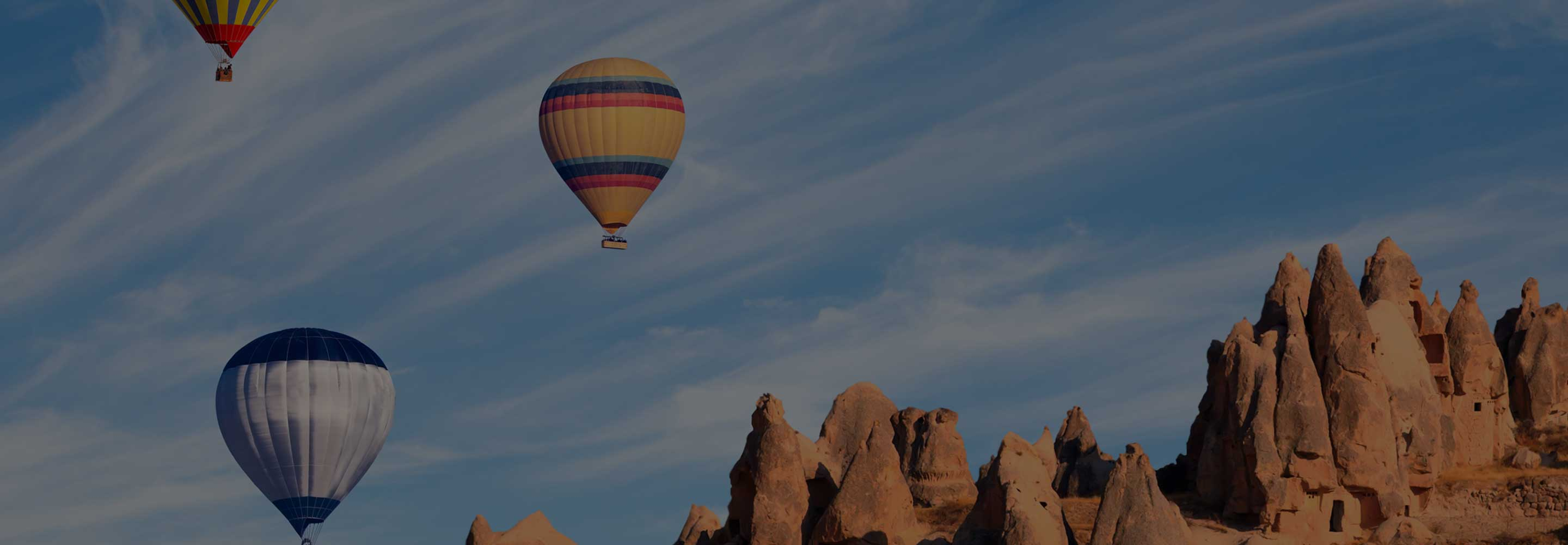 Air balloons in the sky with mountains