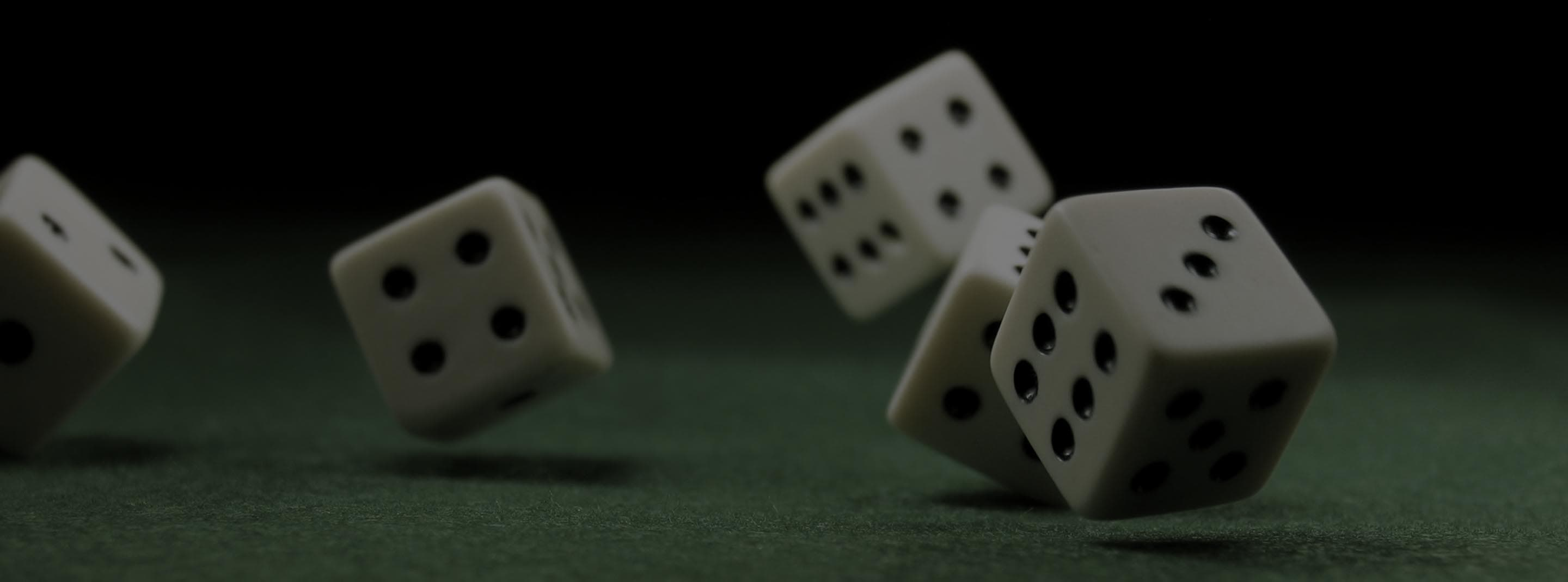 Rolling dice on games table