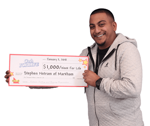 man holding cash for life cheque