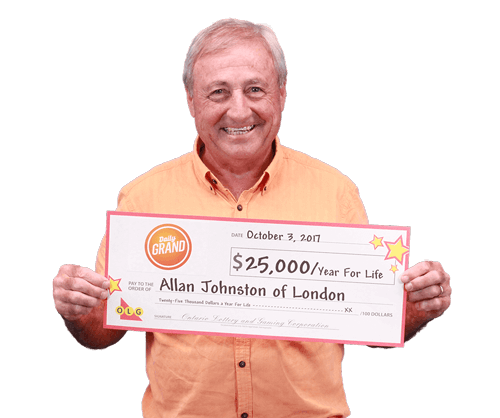 man holding 25,000 a year for life cheque from daily grand 2017