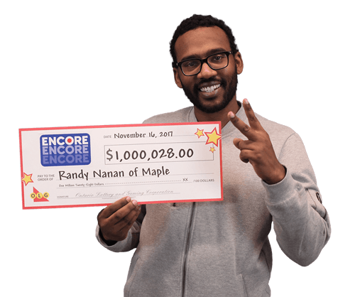 man holding 1 million dollar cheque from encore