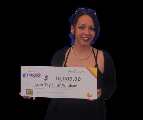 woman holding 10,000 dollar cheque from winning bingo