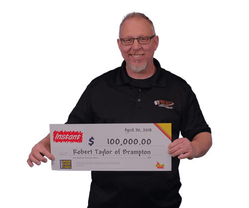 man holding 100,000 dollar cheque from instant