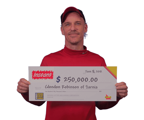 man holding 250,000 dollar cheque from instant