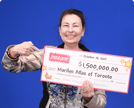 woman holding 1.5 million dollar cheque from instant