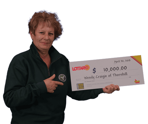 woman holding 10,000 dollar cheque from winning lottario 2018