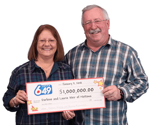 couple holding one million dollar cheque from lotto 649