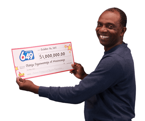 man holding 1 million dollar cheque from lotto 649