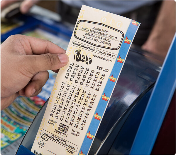 person holding lotto 649 printed ticket