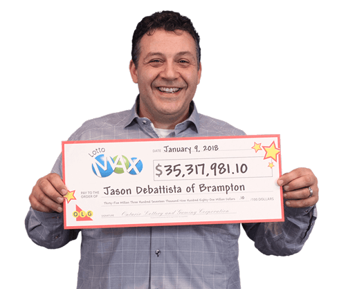 man holding cheque for grand prize from lotto max