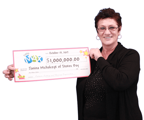 woman holding 1 million dollar cheque from lotto max