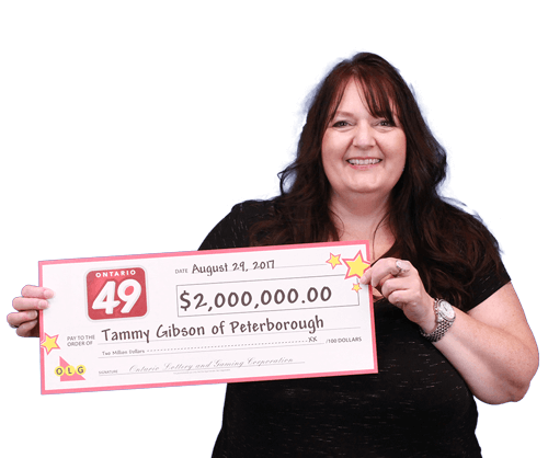 woman holding 2 million dollar cheque from ontario 49
