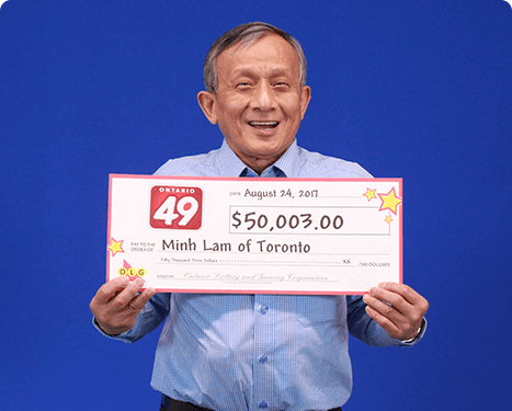 man holding 50,000 dollar cheque from ontario 49