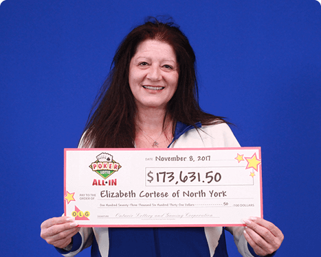 woman holding 173,000 dollar cheque from poker lotto