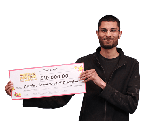 man holding 10,000 dollar cheque from wheel of fortune lotto